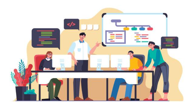 1つの机で4人の人間がプログラミングを学ぶ様子